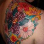 custom color orchid floral back piece cover up tattoo by adal nyc