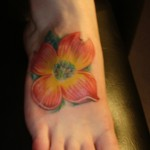 color hibiscus flower foot tattoo
