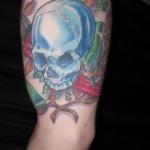 blue chrome skull inner arm laurel reef mechanic tattoo