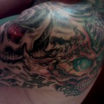 green and red furious psychedelic biomechanical skulls with eyes by Adal