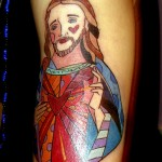 Romero Britto modern Brazilian pop art Jesus Christ arm tattoo by Adal