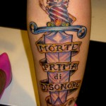 color dagger death dishonor latin text skull tattoo on calf