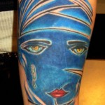 blue color great gatsby arm tattoo by Adal at Majestic