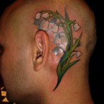 lily flower color head tattoo by Adal