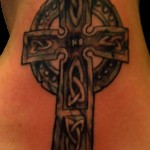 black and grey Irish Celtic tombstone cross female neck tattoo by Adal