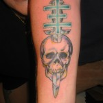 dagger through skull color arm tattoo by Majestic