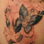 flower shoulder butterfly cover up tattoo in progress