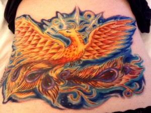 Colorful psychedelic phoenix cover up tattoo