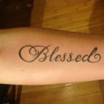 blessed text font script arm tattoo by Adal