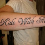 ride with me text font script arm tattoo by Adal
