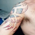 fractal fragmented color shoulder tattoo by Adal