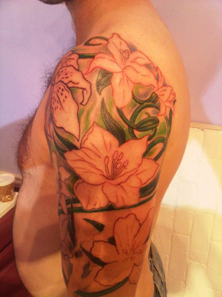 floral sleeve nature modern tattoo