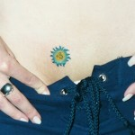 micro small sun hip tattoo