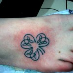 celtic clover micro small foot tattoo