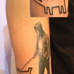banksy tattoo keith haring tattoo walking the dog tattoo street art modern art arm tattoo