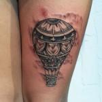 hot air balloon illustration thigh tattoo