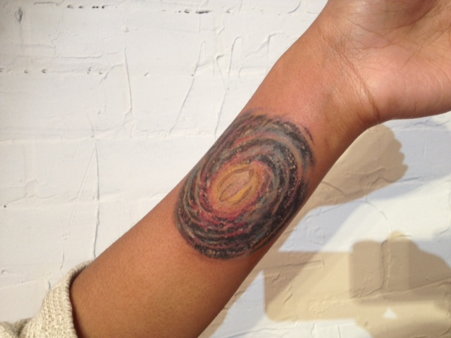 milky way astronomy wrist tattoo by adal at majestic tattoo nyc