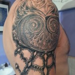 custom black and grey psychedelic fractal owl tattoo by adal at majestic tattoo