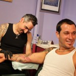 Adal tattooing a sleeve at Majestic
