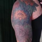 floral sleeve dark colors tattoo