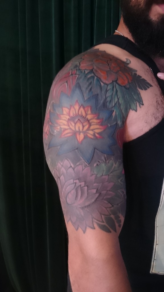 0551163082844 color flowers shoulder piece cover up by Adal. floral sleeve dark colors  tattoo