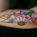 geometric colorful inner bicep tattoo