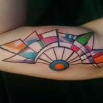 geometric colorful inner bicep tattoo