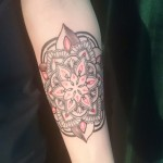 geometric mandala black red forarm tattoo