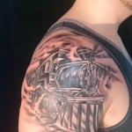 black and grey train shoulder tattoo