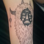 black grey monster tattoo