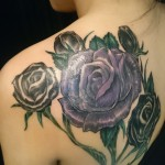 purple rose feminine back tattoo