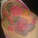 feminine floral botanical pearls shoulder tattoo