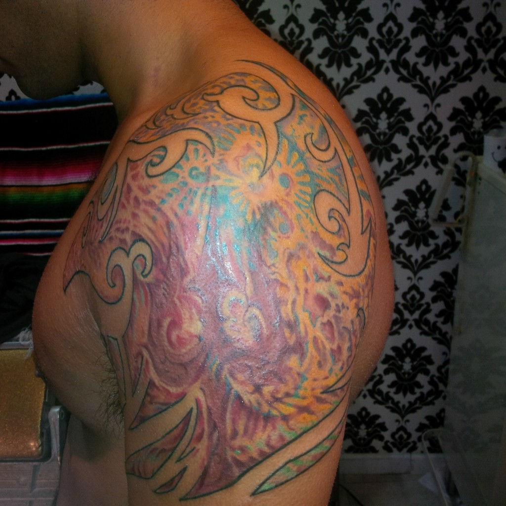 psychedelic fractal shoulder tattoo colorful by majestic tattoo nyc