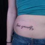 love yourself script hip tattoo